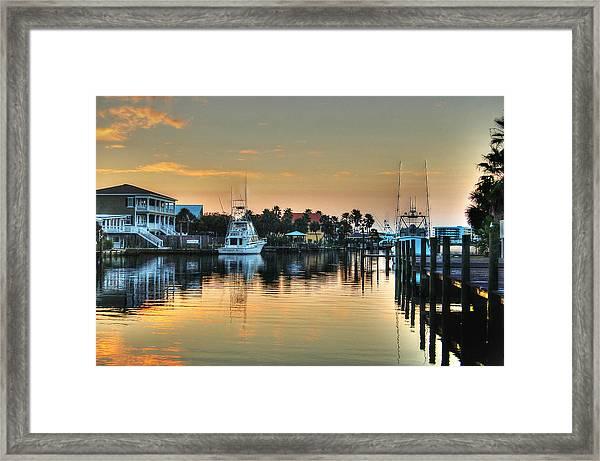 Dawn On A Orange Beach Canal Framed Print