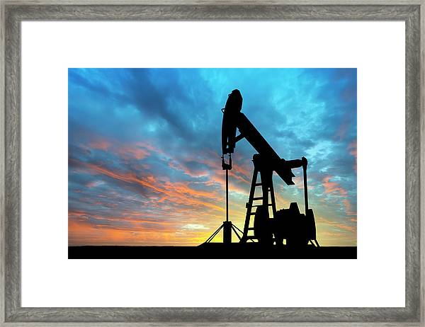 Dawn Over Petroleum Pump Framed Print by Grafissimo