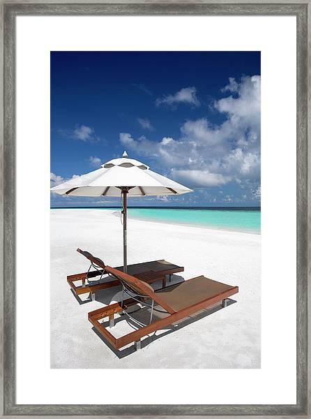 Deck Chairs And Tropical Beach Framed Print