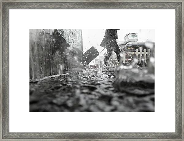 Departure On A Rainy Day Framed Print