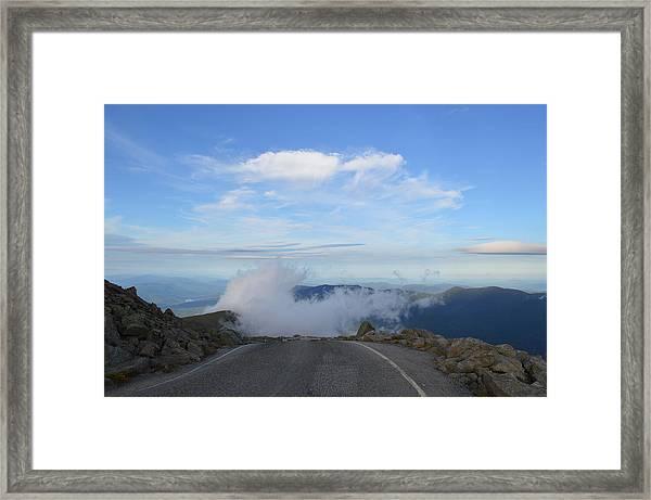 Descending Into The Clouds Framed Print