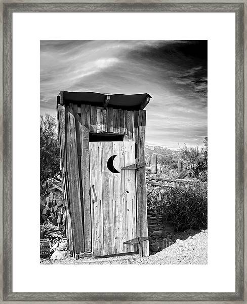 Desert Outhouse Under Stormy Skies Framed Print