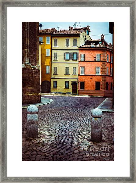 Deserted Street With Colored Houses In Parma Italy Framed Print
