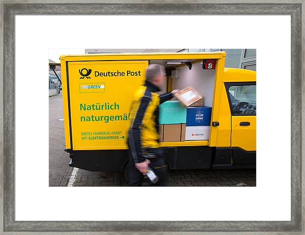 Deutsche Post Ag Unveils Electric Streetscooter Framed Print by Bloomberg