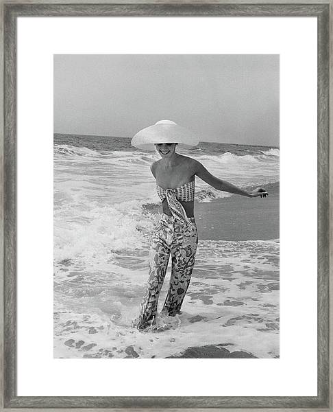 Diana Ewing Playing At A Beach Framed Print