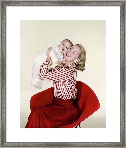Dina Merrill Holding A Baby Framed Print