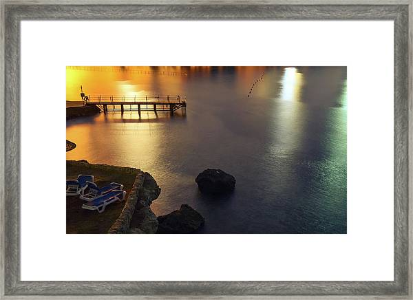 Dock On The Ocean With Lights And Beach Framed Print