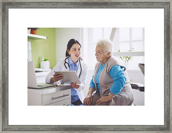 Doctor Consulting Her Patient Framed Print by Eva-Katalin
