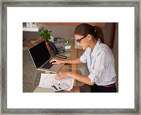 Doing Her Work At Home Framed Print by PeopleImages