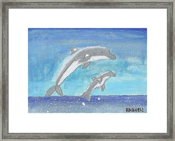 Dolphins Jumping Framed Print by Fred Hanna