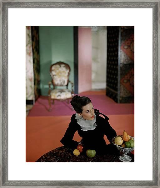 Dorian Leigh Wearing A Mark Mooring Dress Framed Print