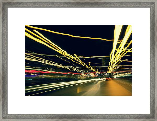 Driving At Night With Abstract City Framed Print