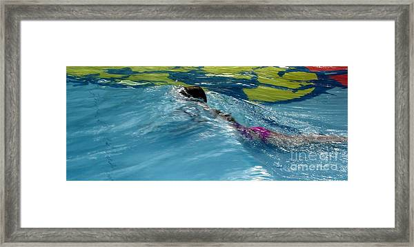 Ducking Under A Wave In A Pool Framed Print