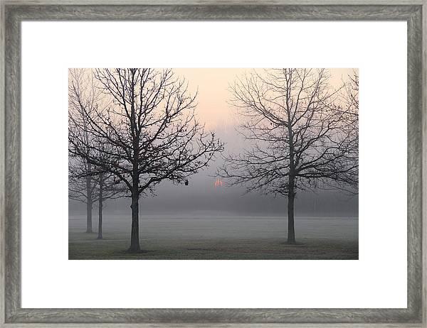 Early She Rises Framed Print
