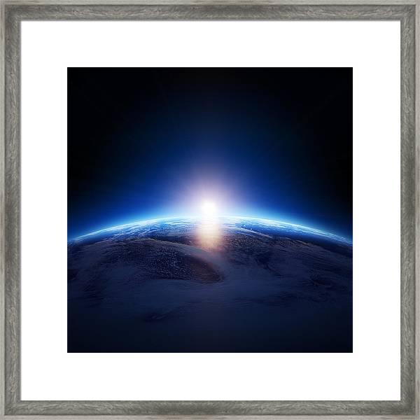 Earth Sunrise Over Cloudy Ocean  Framed Print