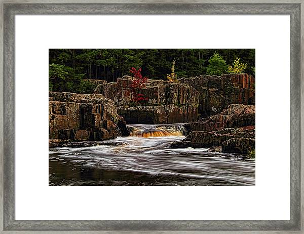 Waterfall Under Colored Leaves Framed Print