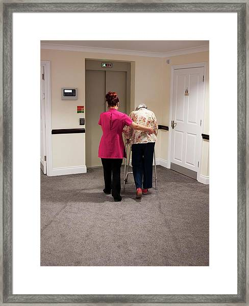 Elderly Woman With Carer Framed Print by John Cole