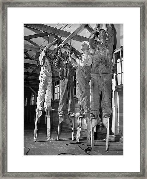 Electricians On Stilts Framed Print