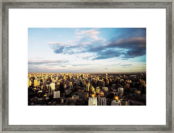 Elevated View Over City At Sunset Framed Print