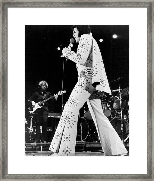 Elvis Presley In White Outfit On Stage Framed Print by Retro Images Archive
