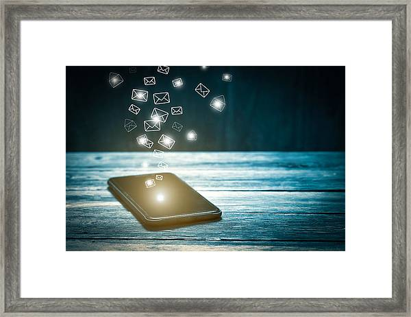 Email Marketing And Many Envelopes In Smartphone Screen Framed Print by Busakorn Pongparnit