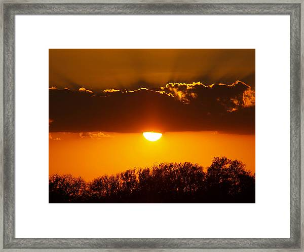 Emergence Of A Golden Sun Framed Print