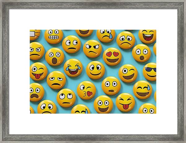 Emoji Badges On Blue Background Framed Print by Dimitri Otis