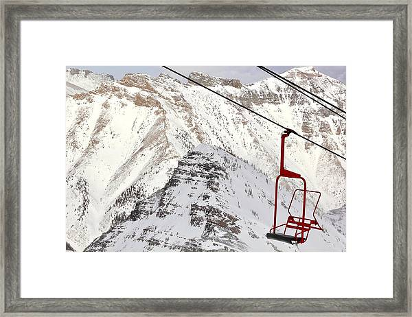 Empty Red Chair Framed Print