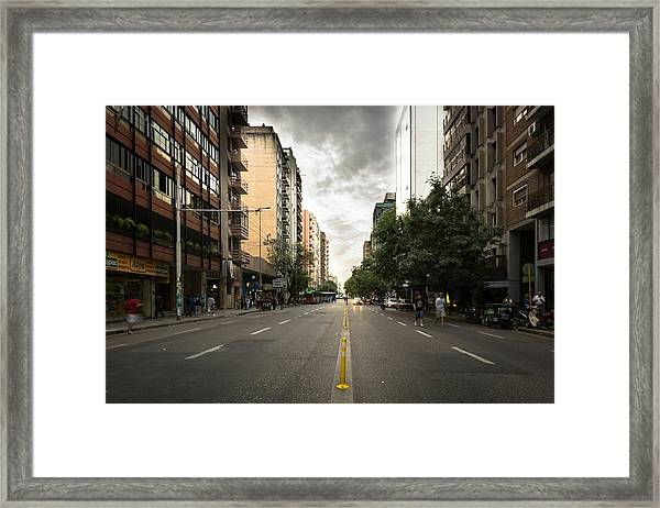 Empty Road Along Buildings Framed Print by Andres Ruffo / EyeEm