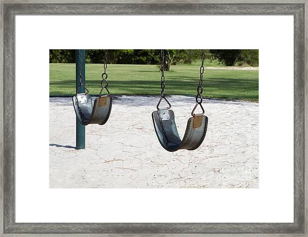 Empty Swings Framed Print