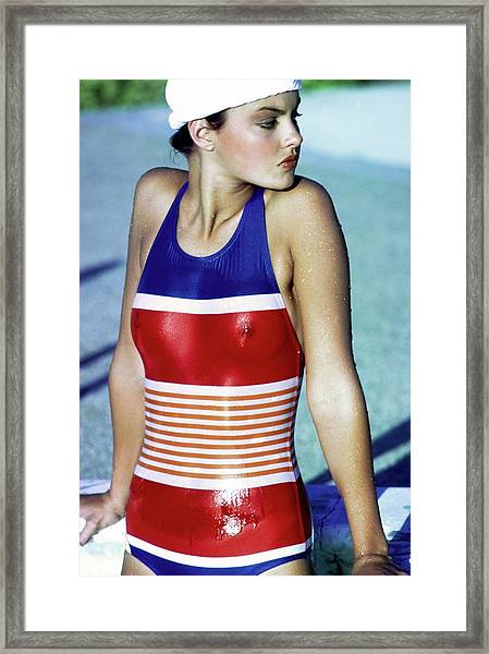 Esme Marshall Wearing A Striped Swimsuit Framed Print by Arthur Elgort