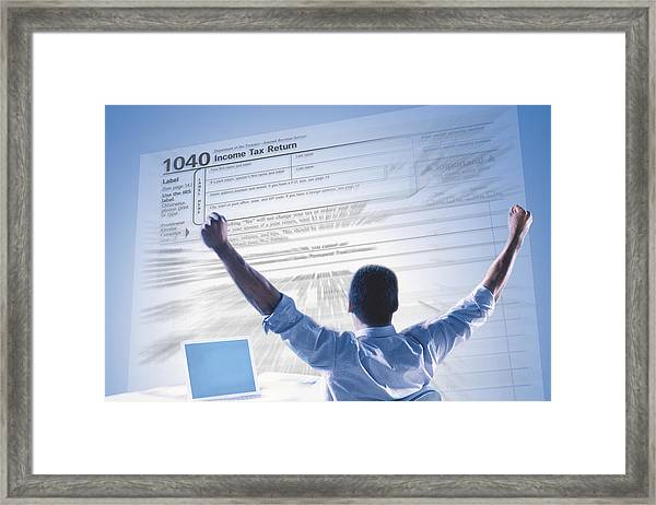 Excited Man And Income Tax Form Framed Print by Comstock