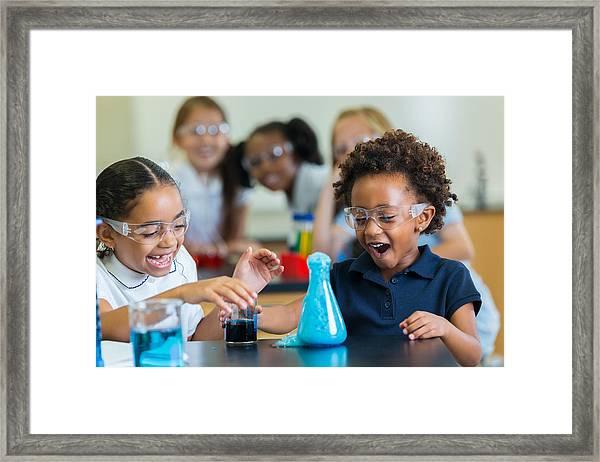 Excited School Girls During Chemistry Experiment Framed Print by Steve Debenport