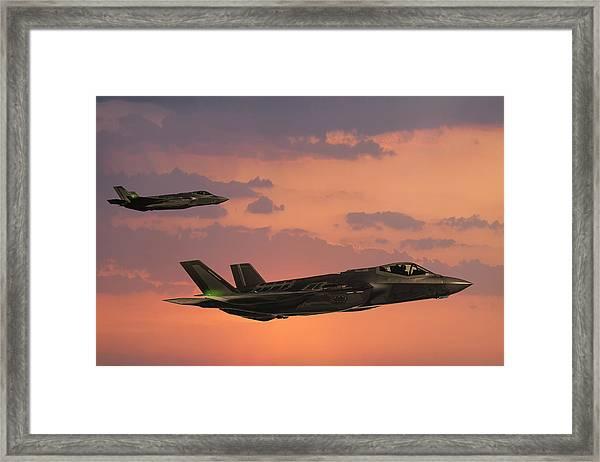F-35 Fıghter Jets In Flight At Sunset Framed Print by Guvendemir