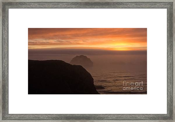 Face Out Of The Fog Framed Print
