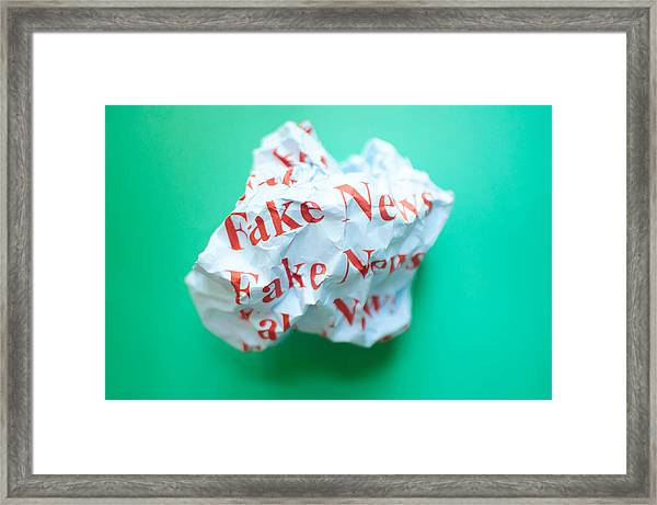 Fake News Against Blue Green Background Framed Print by Karl Tapales