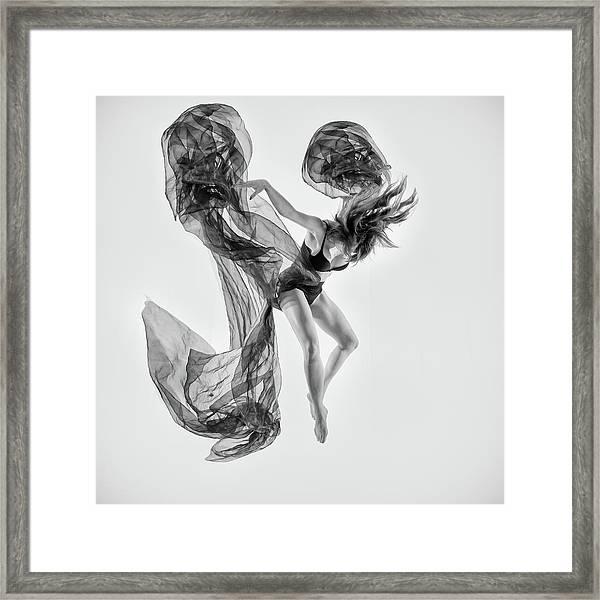 Falling To Earth Framed Print by Peter Elgar