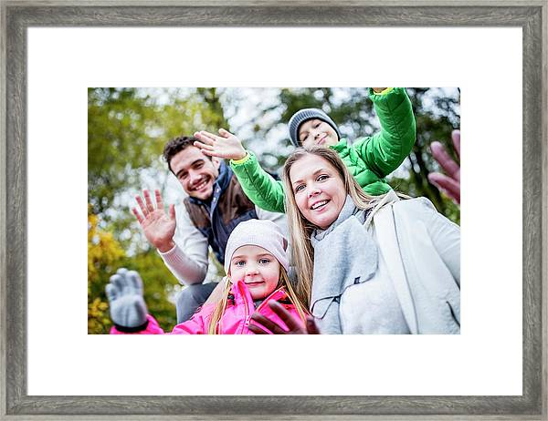 Family Waving Hands Framed Print by Science Photo Library