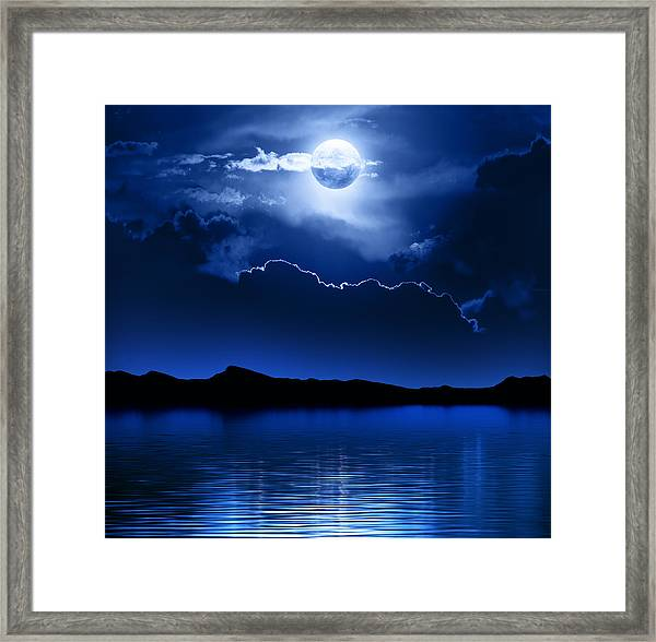 Fantasy Moon And Clouds Over Water Framed Print