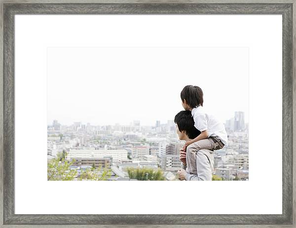 Father And Son On A Hill Framed Print by Kohei Hara