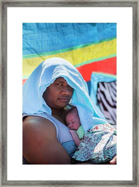 Father Holding Baby Framed Print