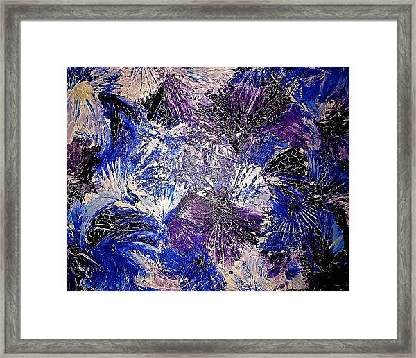 Feathers In The Wind Framed Print