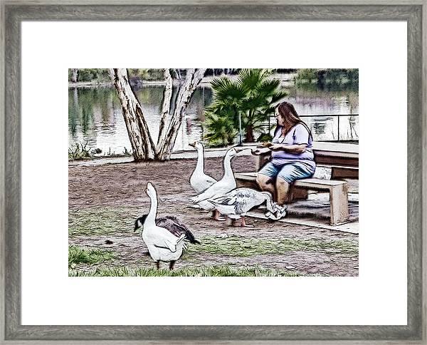 Feeding The Geese Framed Print