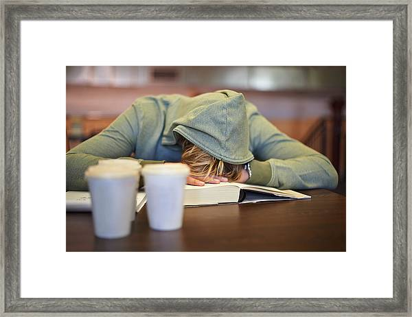 Feeling The Strain Of Looming Exams Framed Print by PeopleImages