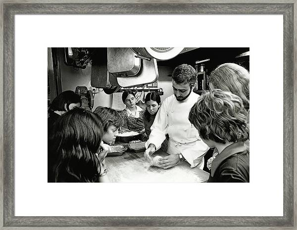 Felipe Rojas-lombardi Teaching Children To Cook Framed Print