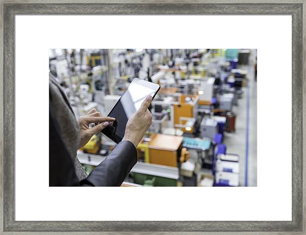 Female Manager Working On Tablet In Factory Framed Print by Yoh4nn