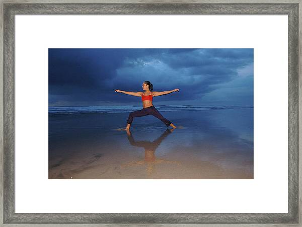 Female Performs Yoga On Beach Framed Print