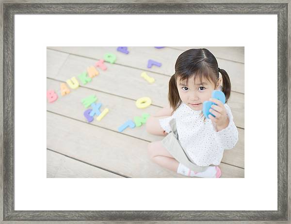 Female Toddler Playing With Educational Toys Framed Print by Image Source