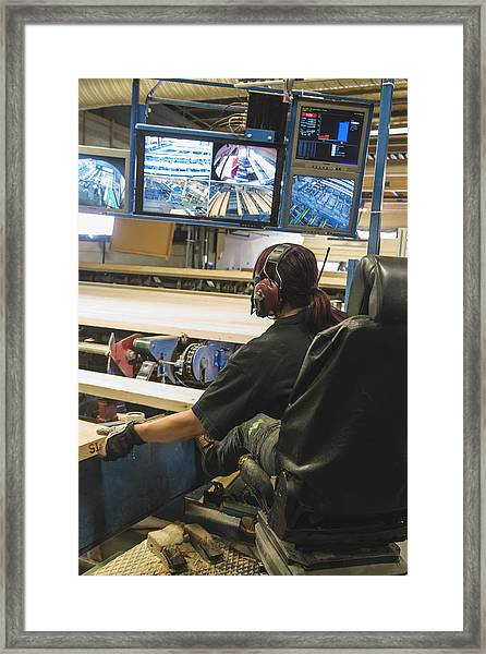 Female Worker Monitoring Computer Screens At Lumber Industry Framed Print by Hakan Jansson