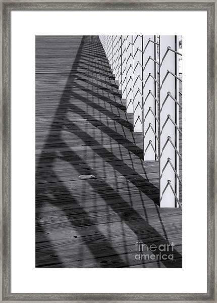 Fence And Shadows Framed Print